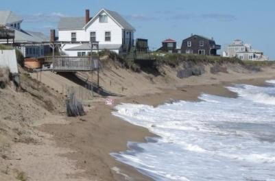 Before:  This beach and dune along the Massachusetts coast were severely eroded, threatening houses and infrastructure. (Source: CZM)