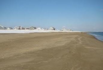 After: Clean, compatible sediment was added to this beach from a nearby dredging project to widen the beach and provide increased storm damage protection to the houses and infrastructure behind it. (Source: CZM)