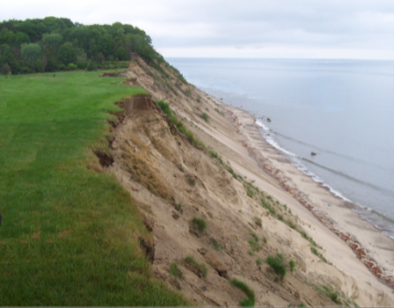 Extensive irrigated lawns on the Massachusetts southern coast have exacerbated erosion of coastal banks. (Photo: CZM)